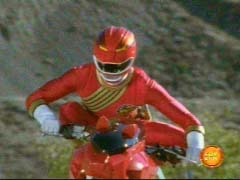 Red Ranger tries to get the hang of his cycle