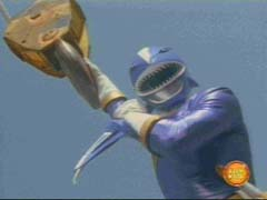 Blue Ranger uses a crane to catch Ship Org offgaurd